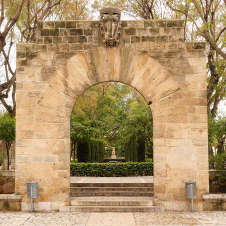 Palma de Mallorca, Spain - March 19, 2019 : public garden and art park in the center of Palma old town next to the kings palace