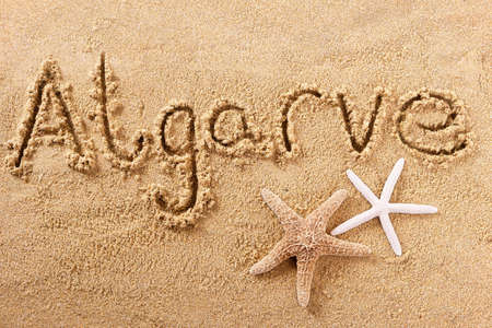 Algarve portugal beach word written in sand