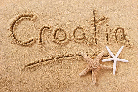 Croatia beach word written in sand 스톡 콘텐츠