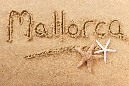 Mallorca majorca beach word sign message written in sand