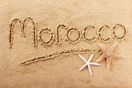 Morocco beach word written in sand 스톡 콘텐츠