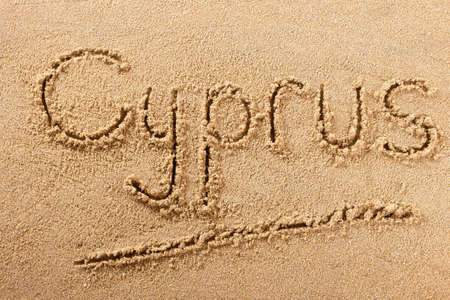 Cyprus beach word written in sand travel message concept