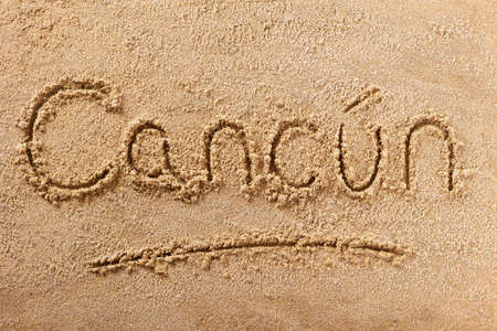 Cancun Mexico beach word written in sand 스톡 콘텐츠