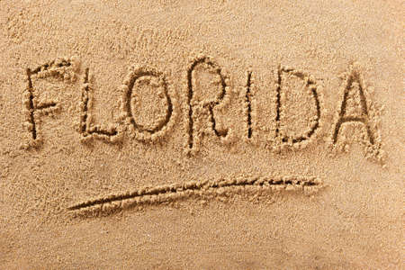 Florida beach sign word written in sand 스톡 콘텐츠