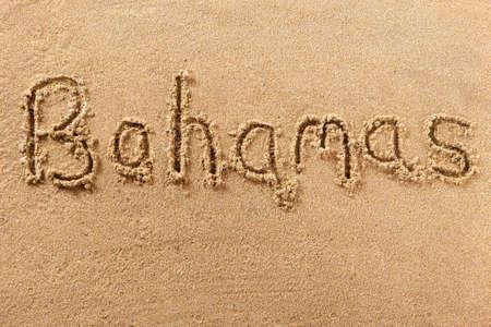 Bahamas beach word message written in sand