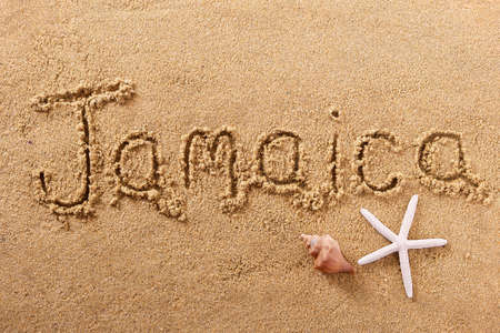 Jamaica beach word written in sand travel concept
