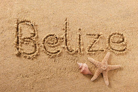 Belize beach word sign written in sand 스톡 콘텐츠