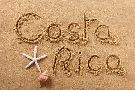 Costa Rica beach word sign written in sand