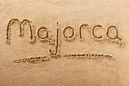 Majorca mallorca beach word sign written in sand holiday concept