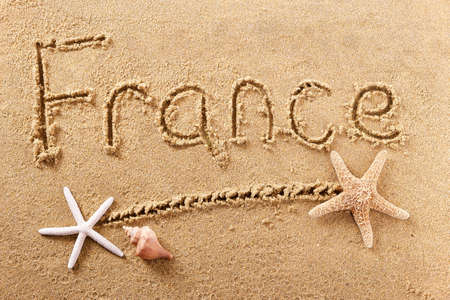 France beach word written in sand holiday travel concept