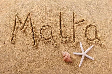 Malta beach word written in sand travel sign concept