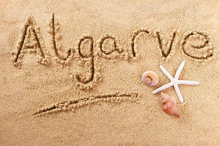 Algarve portugal hand written beach word travel concept 스톡 콘텐츠