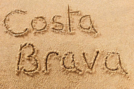 Costa Brava hand written beach word travel concept