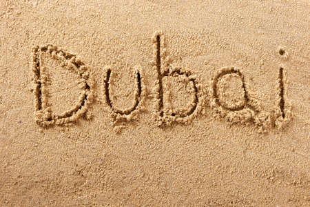 Dubai hand written beach word travel concept 스톡 콘텐츠