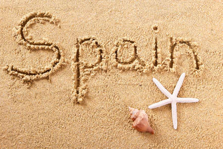Spain beach word travel writing concept