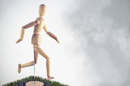 Artist wooden dummy runner in the fog