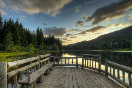 Sunset in Trillium Lake Oregon with view of reflection in lake Stock Photo - 5901397