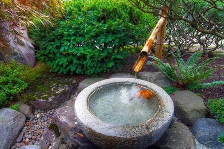 Stone Basin Bamboo Water Fountain in Portland Japanese Garden Stock Photo
