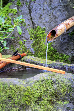 Bamboo Water Fountain with Stone Basin photo