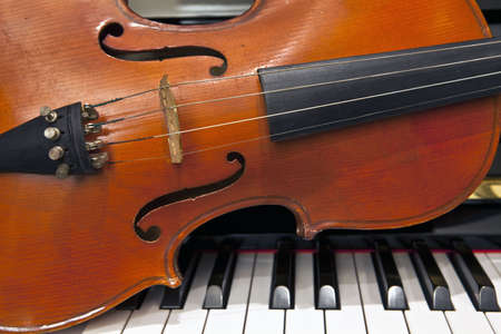 Violin Musical String Instrument on Piano Keyboard photo
