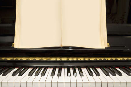 Piano Keyboard with Blank Music Notes Book photo