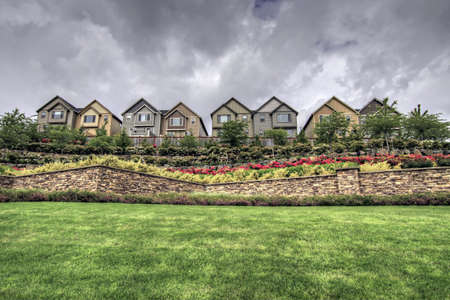 gated: Homes in the Gated Community Suburbs with Stone Walls and Landscaping