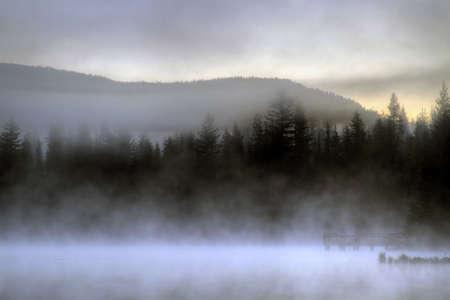 trillium lake: Waiting for Sunrise on the Dock at Trillium Lake one Foggy Morning