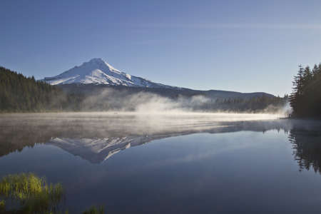 Boating on Trillium Lake with Mount Hood View one Foggy Morning Stock Photo - 7169657