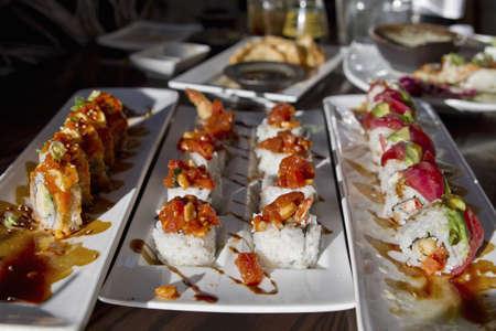 Platters of Sushi Rolls with Shrimp Tempura and Fresh Raw Fish