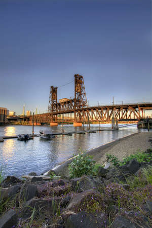 Steel Bridge Portland Oregon from the Marina with Rocks Stock Photo - 7505482