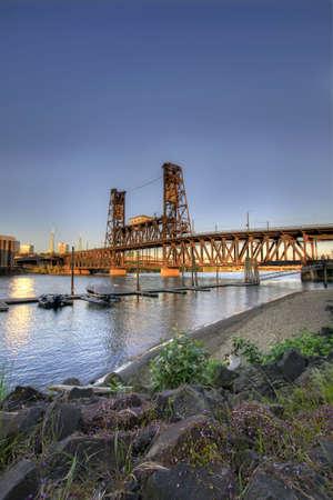 Steel Bridge Portland Oregon from the Marina with Rocks Stock Photo - 7505482