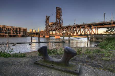 Steel Bridge Portland Oregon from the Marina with Iron Bollard Stock Photo - 7505486