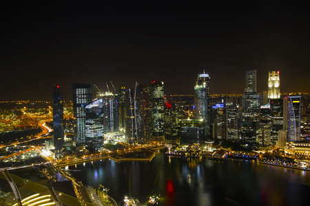 Singapore City Skyline by River at Night Aerial View