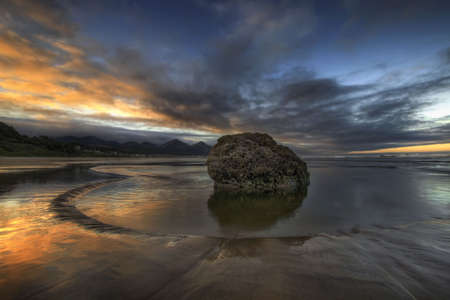 Rock at Low Tide on Cannon Beach Oregon at Sunrise photo