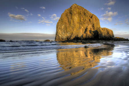 Reflection of Haystack Rock at Cannon Beach Oregon 2 Stock Photo