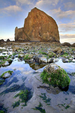 Haystack Rock in Cannon Beach Oregon at Low Tide Stock Photo
