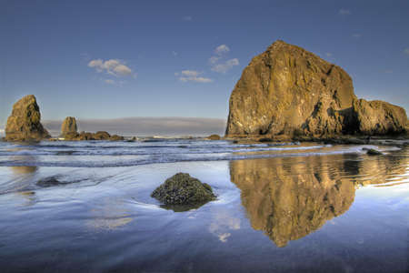 cannon: Reflection of Haystack Rock at Cannon Beach Oregon 3