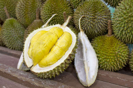 flesh: Durian open in display with yellow flesh on fruit stand in tropical country 2