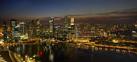 Singapore City Skyline by River at Dusk Aerial View Panorama