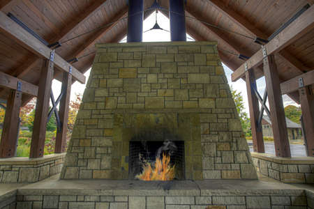 stone fireplace: Outdoor Garden Backyard Stone Fireplace in Public Park Stock Photo