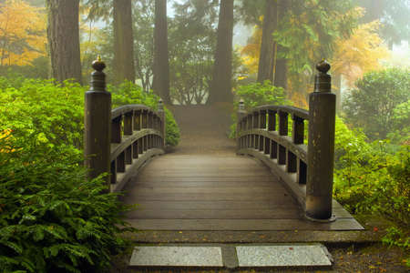 Wooden Bridge at Portland Japanese Garden in Fall One Foggy Morning