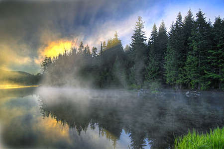 Sunrise and Reflection Over Trillium Lake Oregon Stock Photo