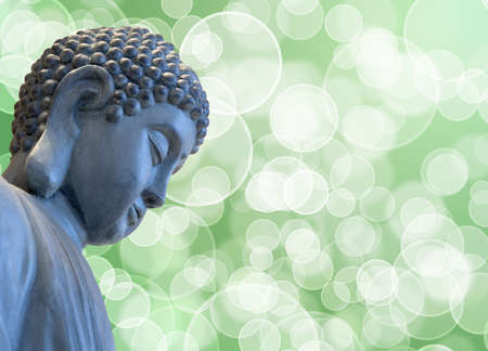 Bronze Zen Buddha Statue Meditating with Blurred Background