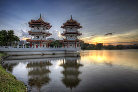 Twin Pagodas at Singapore Chinese Garden Lake at Sunset