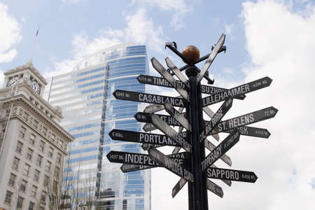 signpost: Directional Signpost to World Landmarks in Downtown Portland Oregon Stock Photo
