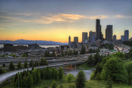northwest: Seattle Washington Skyline and Freeway at Sunset Stock Photo