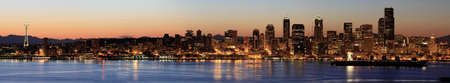 puget: Seattle Downtown Skyline at Dawn along Puget Sound Panorama Stock Photo