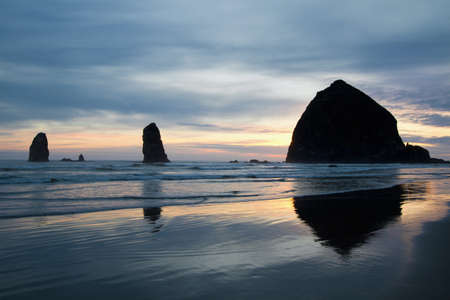 Haystack Rock and the Needles on Cannon Beach at Oregon Coast Stock Photo - 10009861