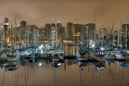 Marina along Stanley Park with Vancouver British Columbia City Skyline photo