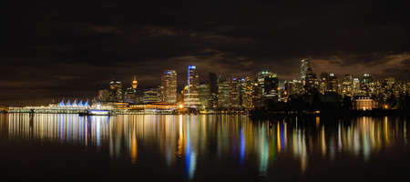 vancouver island: Vancouver BC Downtown City Skyline Along Waterfront at Night Panorama